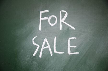 for sale title written chalk on blackboard photo