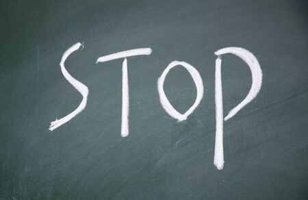 stop title written written chalk on blackboard Stock Photo - 12049240