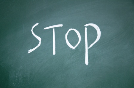 stop title written written chalk on blackboard photo