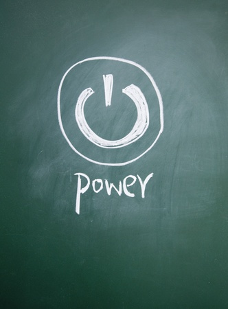 power sign drawn with chalk on blackboard photo