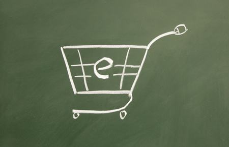 Electronic shopping cart drawn with chalk on blackboard photo