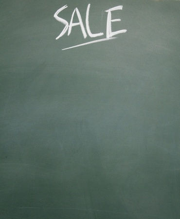 detriment: sale title written chalk on blackboard