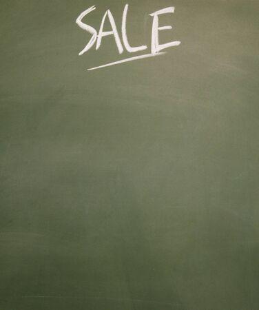 detriment: sale title written chalk on blackboard