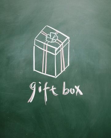 gift box sign drawn with chalk on blackboard photo