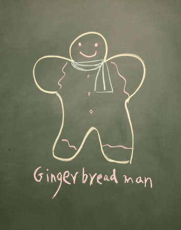 gingerbread man drawn with chalk on blackboard photo
