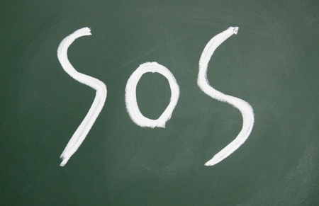sos title written with chalk on blackboard photo