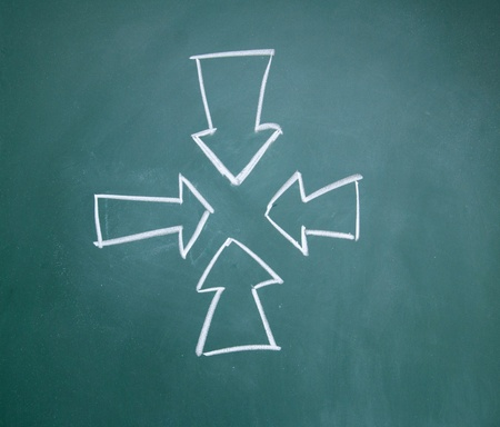 arrows drawn with chalk on blackboard Stock Photo - 12292735