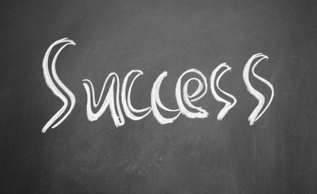 success title written with chalk on blackboard photo