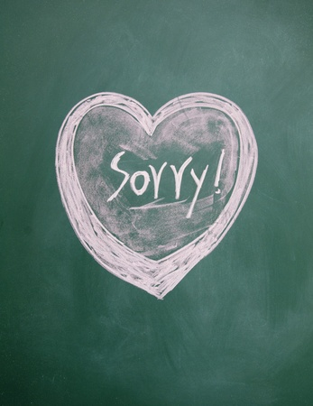 sorry title and heart sign drawn with chalk on blackboard photo