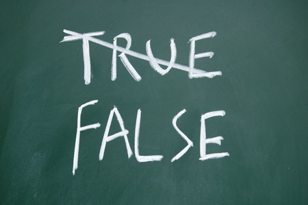 true and false title written with chalk on blackboard photo