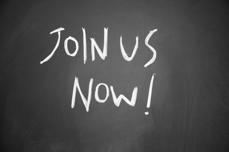 join us now title drawn with chalk on blackboard Stock Photo