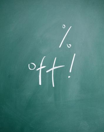 % off written with chalk on blackboard photo