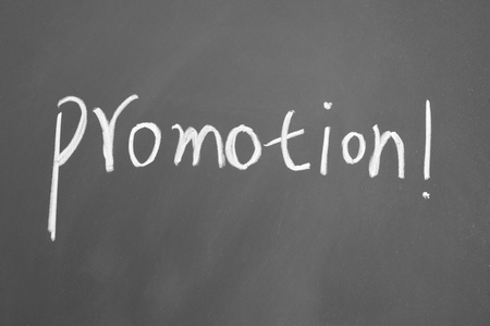 promotion title written with chalk on blackboard photo
