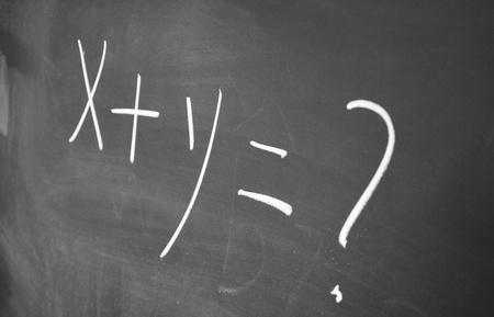 x+y=? title written with chalk on blackboard photo