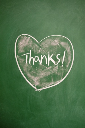 thanks title and heart sign drawn with chalk on blackboard Stock Photo - 12649596