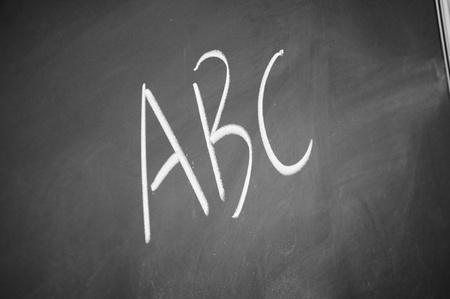 abc title written with chalk on blackboard photo