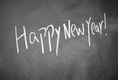 lacunae: happy new year title written with chalk on blackboard Stock Photo