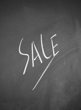 detriment: sale title drawn chalk on blackboard Stock Photo