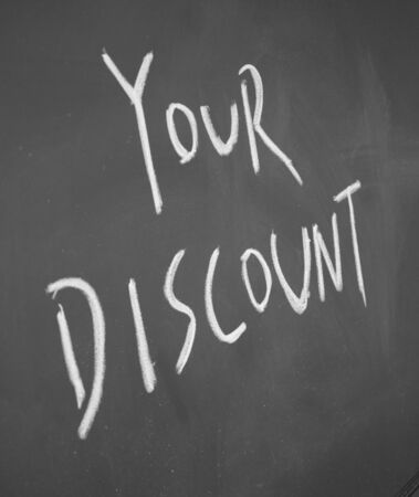 your discount title written chalk on blackboard photo