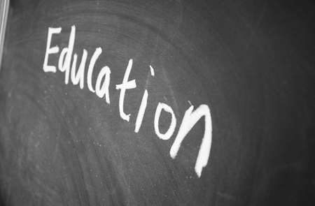 education title written chalk on blackboard photo
