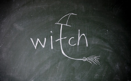enchantment: witch title drawn with chalk on blackboard