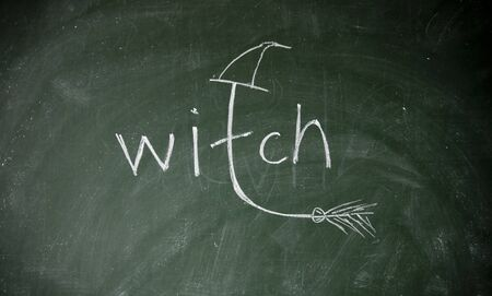 daemon: witch title drawn with chalk on blackboard