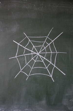 cobweb drawn with chalk on blackboard photo