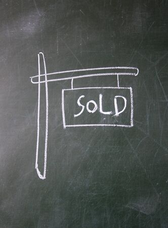 detriment: sold sign drawn with chalk on blackboard