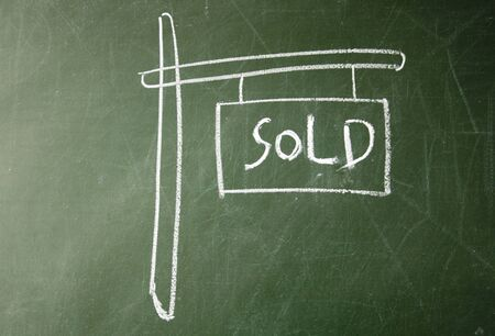 blankness: sold sign drawn with chalk on blackboard