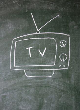 tv drawn with chalk on blackboard photo