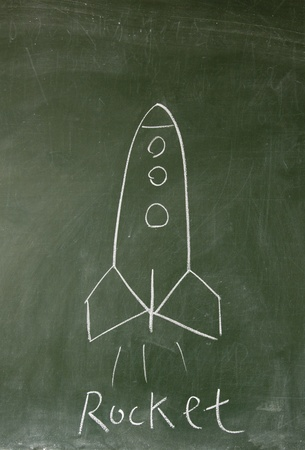 rocket drawn with chalk on blackboard photo