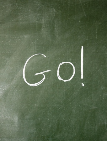 environmentalist tag: go title written with chalk on blackboard Stock Photo