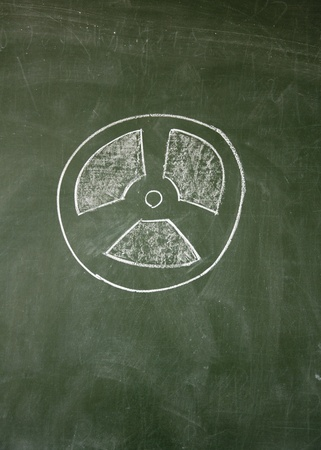 nuclear radiation sign drawn with chalk on blackboard