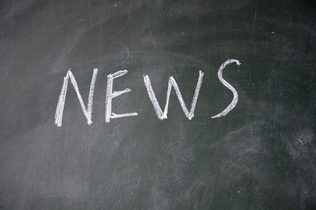 news title written with chalk on blackboard photo