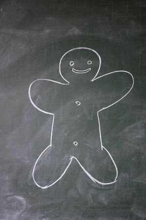 biscuit man drawn with chalk on blackboard photo