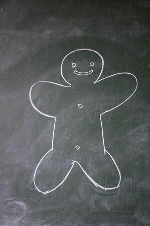 biscuit man drawn with chalk on blackboard photo