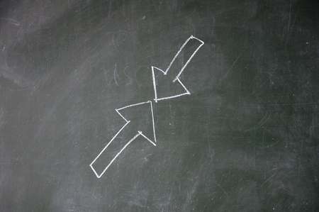 counterpoise: arrows drawn with chalk on blackboard