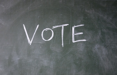 vote title written with chalk on blackboard photo