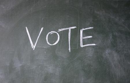 vote title written with chalk on blackboard Stock Photo - 12648677