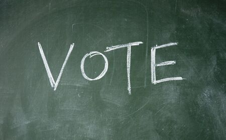 vote title written with chalk on blackboard Stock Photo - 12649339
