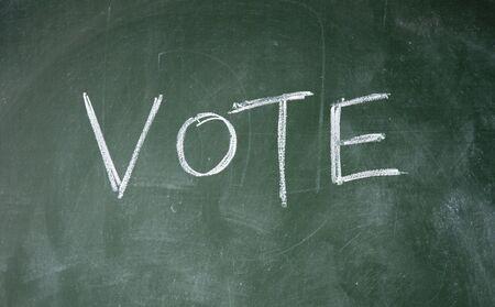 vote title written with chalk on blackboard Stock Photo - 12649339