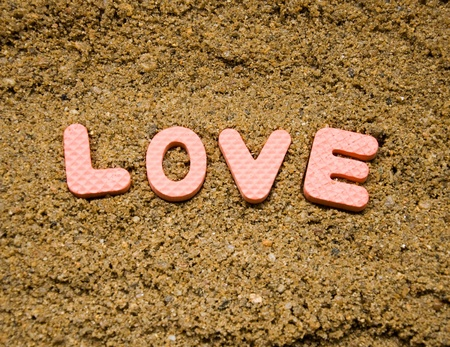 love sign and sand background photo