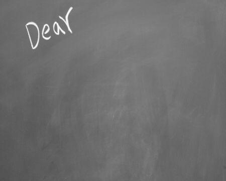 dear: dear title written with chalk on blackboard