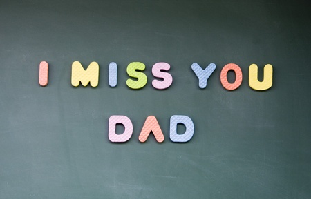 miss you: I miss you dad sign drawn with chalk on blackboard