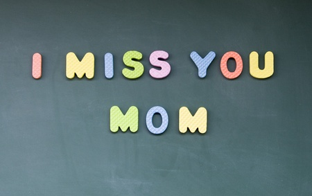 i miss you: I miss you mom sign drawn with chalk on blackboard