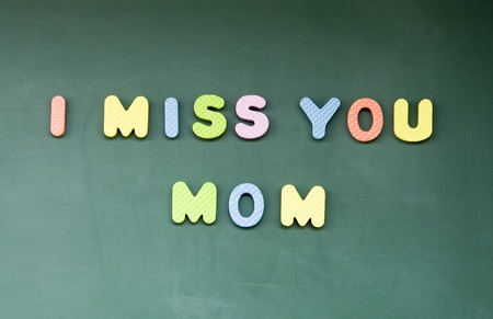 I miss you mom sign drawn with chalk on blackboard photo