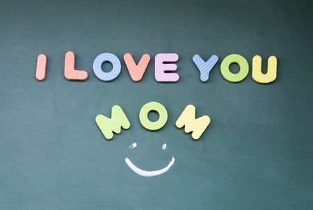 mama: I love you mom sign drawn with chalk on blackboard