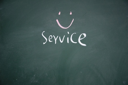 service symbol drawn with chalk on blackboard photo
