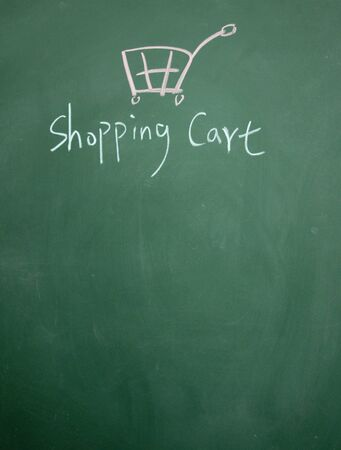 shopping cart drawn with chalk on blackboard photo
