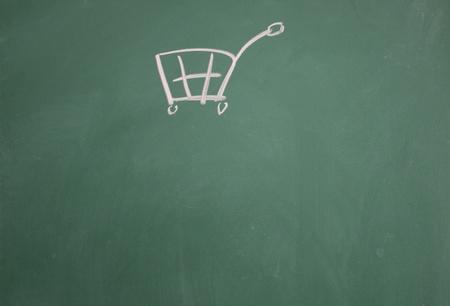 shopping cart symbol drawn with chalk on blackboard Stock Photo - 12895486